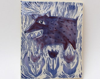 dog in the tulips hand carved ceramic art tile