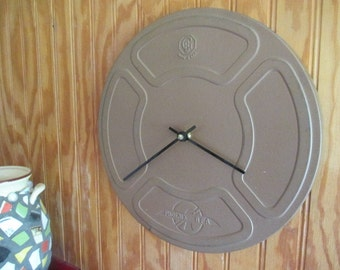 "16 mm Film Canister Clock - FREE SHIPPING - Repurposed and Upcycled Wall Clock - 12"" Diameter"