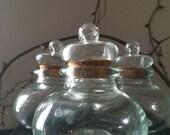 GLASS SUPPLIES...short wide glass jars bottles cork lined stoppers perfume oil flower design vases