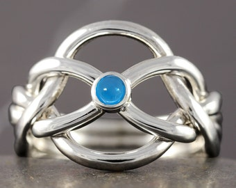 Blue topaz infinity knot puzzle ring in sterling silver