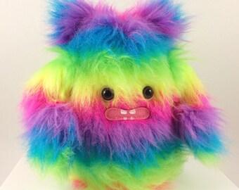 Fuzzy Rainbow Plush Monster