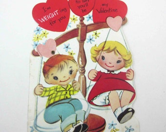 Vintage Mechanical Valentine Greeting Card with Little Girl and Boy on Weight Scales Weigh