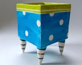 ceramic Planter with whimsical bright blue, polka-dots, chartreuse, black & white striped beetlejuice legs
