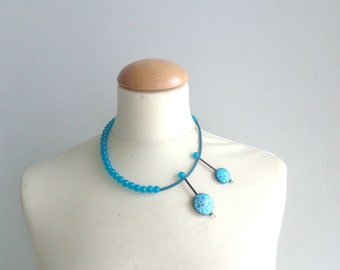Blue  asymmetric statement rubber necklace