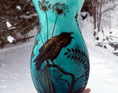 Lost Raven Amongst the Wildflowers Sculpted with polymer Clay onto a Recycled Glass Vase in Turquoise