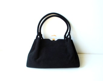 Art deco vintage 40s black genuine kid suede, hand made bag with a round clear lucite clasp. Made by Koret.