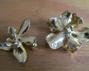 two gold dipped flowers