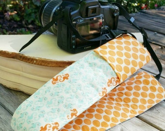 Padded DSLR camera strap cover, reversible padded camera strap cover, slip on strap cover in orange and blue seahorse and polka dots