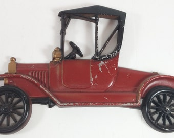 Vintage wall hang black and red cast iron car old car design made in usa