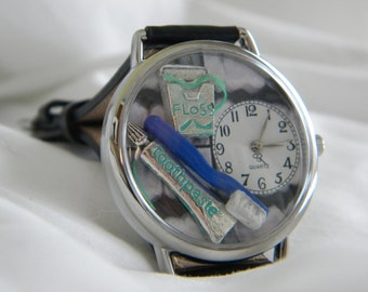 Dentist or Dental Hygienist Watch with Floss Toothbrush and Toothpaste