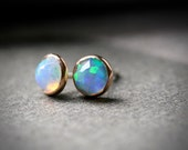 Bezel set 5mm faceted opal stud earrings set in solid 14k rose gold
