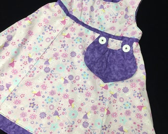 Reversible Pink fairies dress sizes 1-4 years