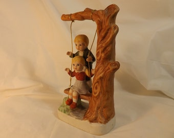 FREE SHIPPING vintage figurine children on swing (Vault 5)