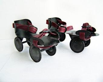 Vintage Black Metal Childs Rollerskates with original pleather straps 1940s toy skates for kids great home decor item prop or display