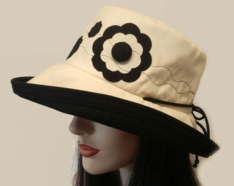 Sunblocker - Full brim sun hat with adjustable fit made from Natural cotton canvas featuring applique flowers