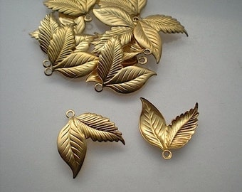 12 small brass double leaf charms
