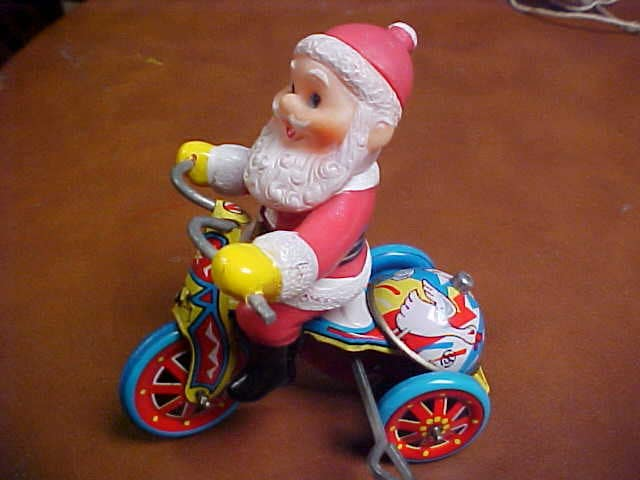 Toys That Were Made In The 1970 : Tin toy bicycle with riding santa wind up made in