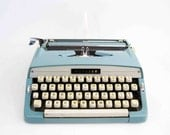 Vintage Webster Portable Typewriter in Baby Blue by Brother. Made in Japan. Circa 1960's.