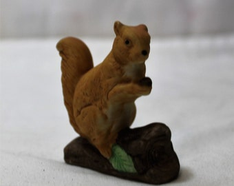 Small Bisque Porcelain Squirrel on a Log Figurine