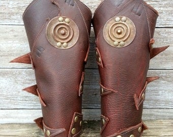 Primitive Oiled Brown Leather Peaked Bracer Pair with Brass Ethiopian Shield & Antiqued Brass Accents
