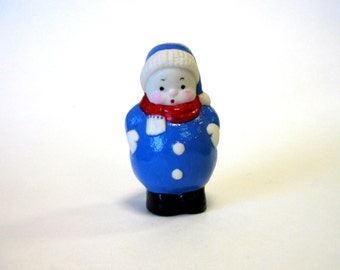 "Boy 3"" cast in white porcelain chubby little fellow in a snow suit"