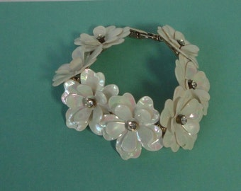 1940s Gold tone metal with Iridescent White Celluloid Flowers and Rhinestones Bracelet.