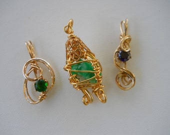 Trio of Rolled Gold Pendants with stones
