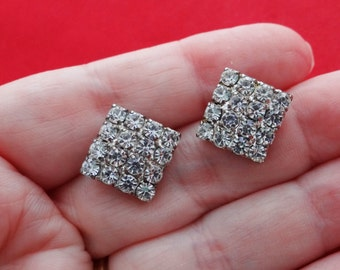"Vintage .75"" rhinestone and silver tone pierced earrings in great condition, appears unworn"