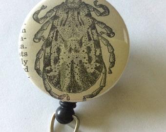 Tick Vintage Dictionary Badge Holder