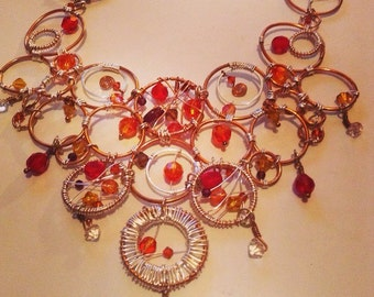 Copper Wire and silver wire wrapped bib style necklace with faceted garnet and swarovski crystals