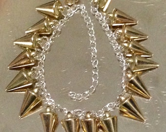 Gold spike charms on chain