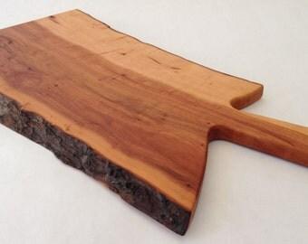 Apple wood live edge cutting board.