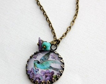 SALE Turquoise and Purple Bird Necklace in Antique Brass.