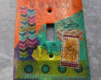 India Colors, switch plate cover, toggle, mixed media, collage, Indian motifs, eye, one of a kind