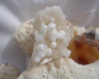 Okenite on Prehnite with Apophyllite Cubes