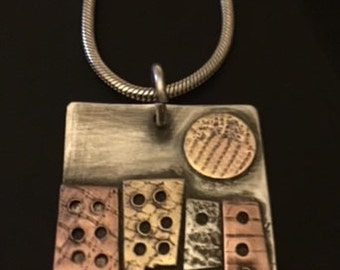 Sterling Silver Pendant with Silver, Brass, and Copper building and Moon