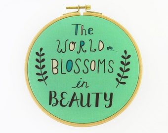 The World Blossoms in Beauty Hoop Art - Canvas Print in Embroidery Hoop - Fabric Gallery Wall Art - Motivational Nursery Wall Art