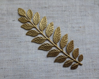 Beautiful brass leaf design stamping. Lot of 1 leaf stamping.