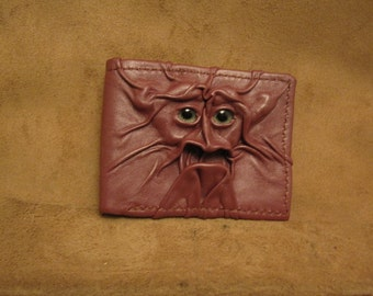 Grichels leather bi-fold wallet - silvery mauve with green carousel horse eyes