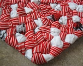 Be My Valentine Braided Fabric Heart Trivet / Doily in candy cane red , white, and specks of black from recycled fabrics
