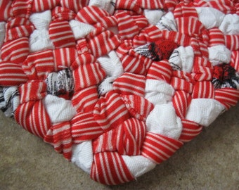 Candy Cane Braided Fabric Heart Trivet / Doily / Hot Pad in  red , white, and specks of black from recycled fabrics