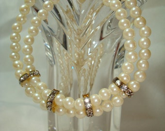 1994 Dual Strand Pearl Like with Rhinestone Rondel Accent Pieces.