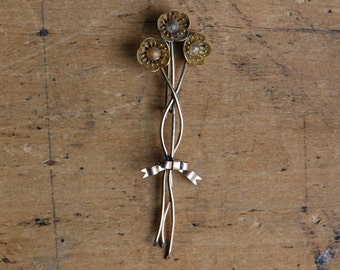 Antique Victorian long flower pin with bow