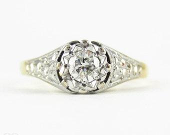 Vintage Diamond Single Stone Engagement Ring, Round Brilliant Cut 0.20 ct Diamond in Engraved Illusion Setting. Circa 1940s, 18 Carat Gold.