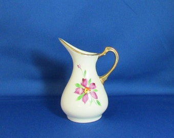Modernist Style Pitcher Shaped Purple Floral Vase Off white with a purple flower and green leaves which appears hand painted