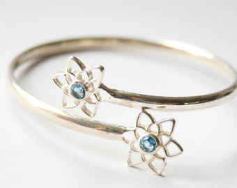 Vintage sterling silver bangle.  Blue topaz bangle. Flower bangle