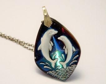 Vintage dolphin pendant. Multi coloured glass pendant.  Reverse-carved pendant