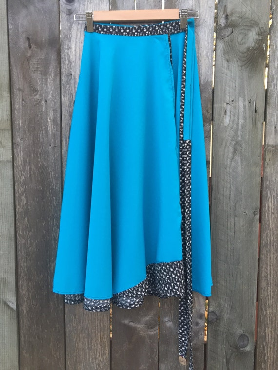 Blue, black and white wrap skirt. One size fits most