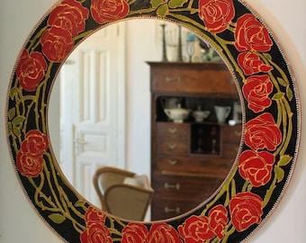 round decorative dramatic red roses mirror