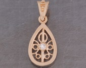 14 karat yellow gold teardrop, antique style diamond pendant
